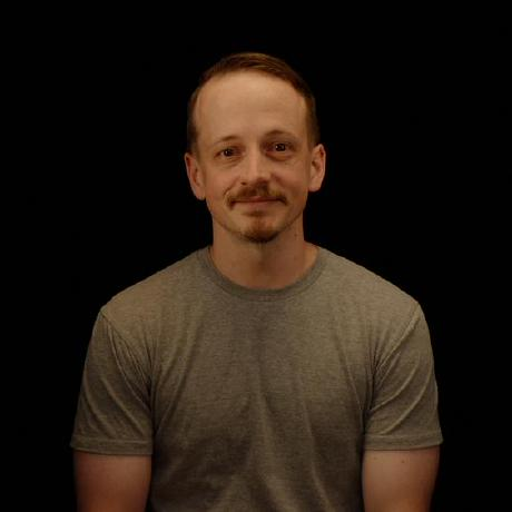Richard Moot throwing a playing card